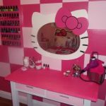 white-and-pink-ribbon-hellokitty-wall-mirror-on-white-pink-squares-wall-also-pink-and-white-dressing-table-with-purple-hairdryer-and-cosmetics