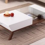 white coffee table idea with drawers and small glass top panel in the middle and also wooden legs