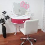white-pink-ribbon-hello-kitty-wall-mirror-above-red-white-dresser-with-white-chair-and-white-wall-also-black-vas-and-flower