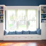 window seats with storage with amazing design adorned with blue cushions and book case above the cabinets plus awesome wooden floor