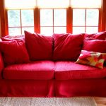 wondrous red couch cover for sectional idea with red pillows and floral cushion on gray rug with glass bar window and table lamps