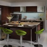 wondrouse kitchen design with large island with extended bar table and green stools and wooden cabinetry and white flooring