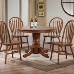 40 round nostalgia pedestal dining table made of wood together with 4 chairs and beige rug plus mirror on wall