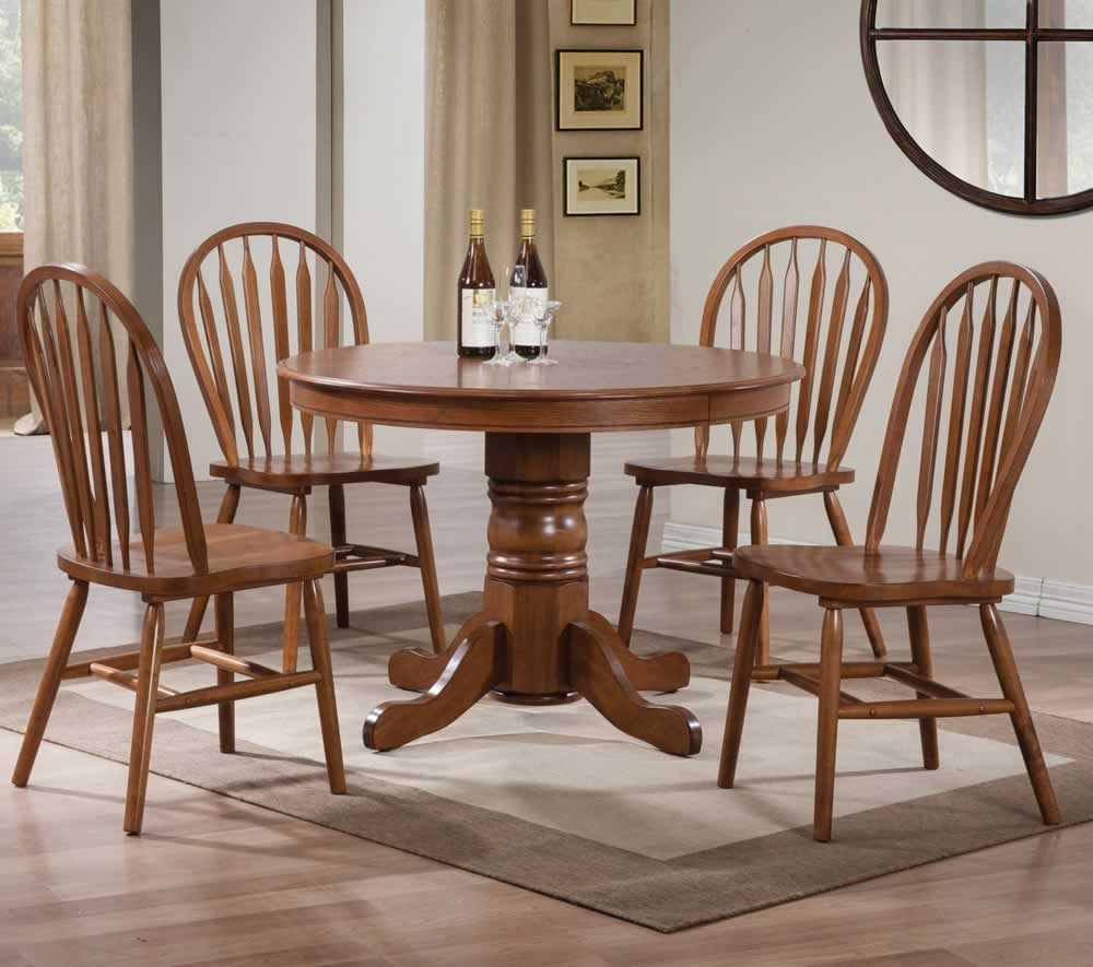 40 Round Nostalgia Pedestal Dining Table Made Of Wood Together With 4  Chairs And Beige Rug