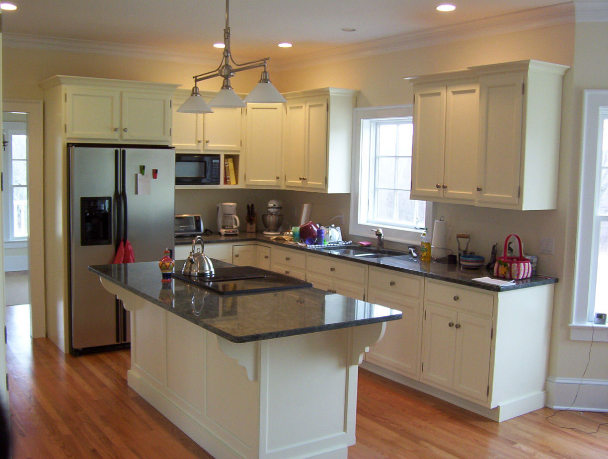 Kitchen With Cherry Cabinets And White Appliances