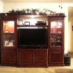 Best Cherry Wood Entertaining Furniture With Modern Tv And Storage Place Decorated with Lighting