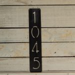 Black Vertical Address Plaques On Wooden Wall