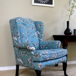 Blue Turquoise Design Of Upholstered Wingback Chair Near Dark Wooden Table And Frame