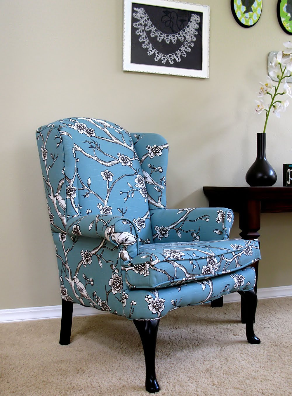 Exceptionnel Blue Turquoise Design Of Upholstered Wingback Chair Near Dark Wooden Table  And Frame