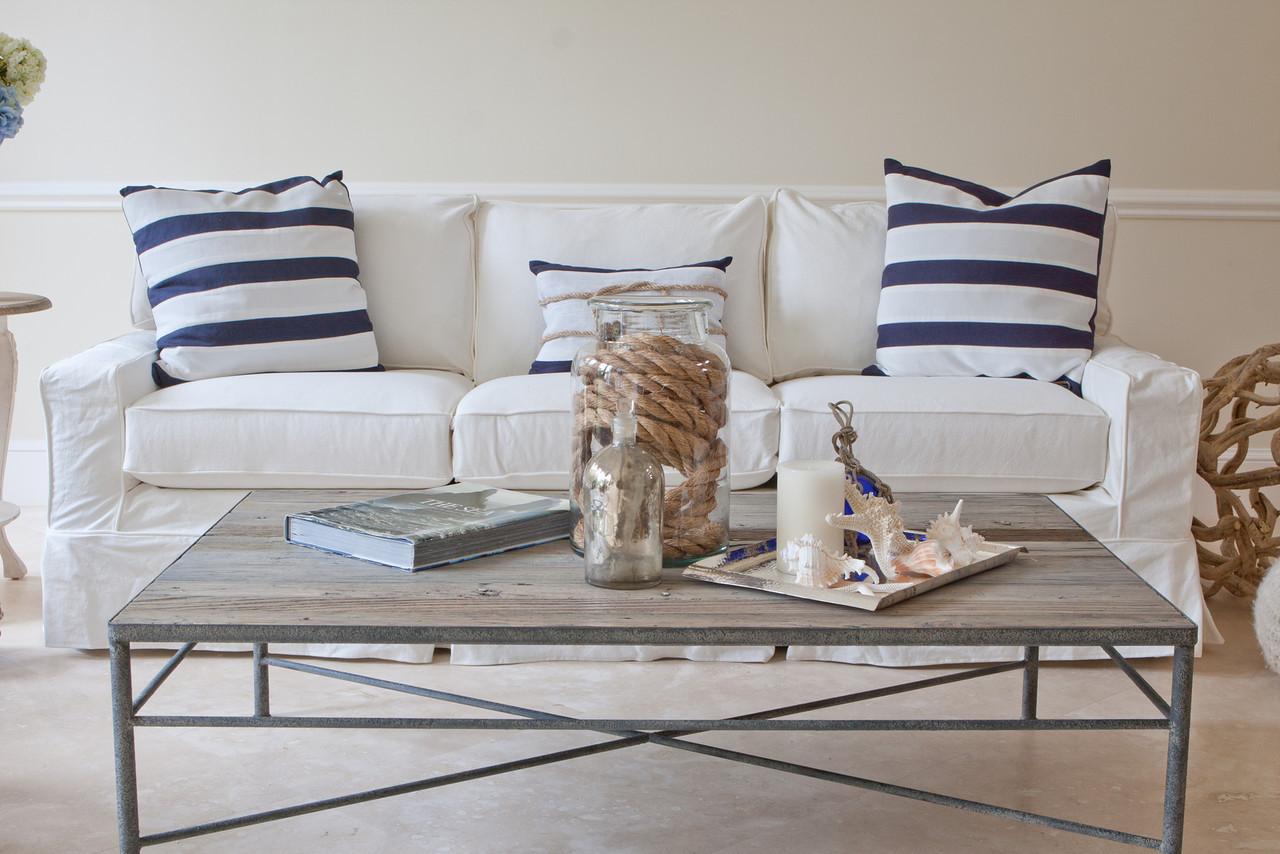 Blue White Striped Pillows On White Slipcovered Sofa Wth Rectangular Main  Table