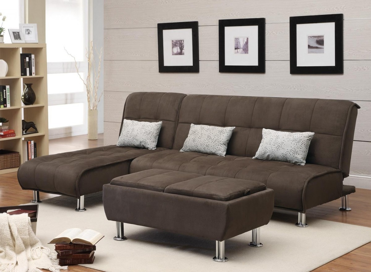 brown apartment size sleeper sofa with triple piilows and cream color