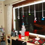 Christmas Decor Big Window With White Curtains Near Wooden Cabinet