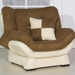 Comfy chair transformed into bed in white and brown