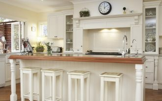 Country Kitchen Design With White Cabinet And White Wood Bar Stools