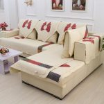 Cream slipcover with beautiful red ribbon decorations for sectional sofa with chaise