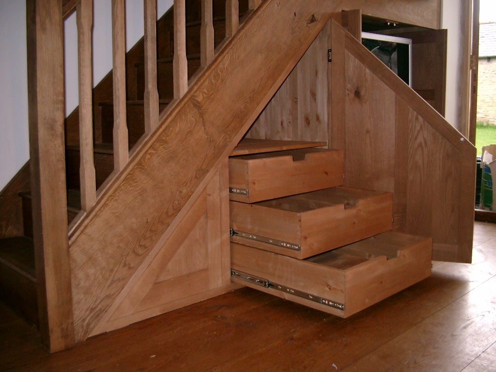 Cupboard under the stairs arrangement homesfeed for Under stairs drawers plans