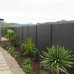 Dark Wall Fence Panels With Pathways And Small Garden
