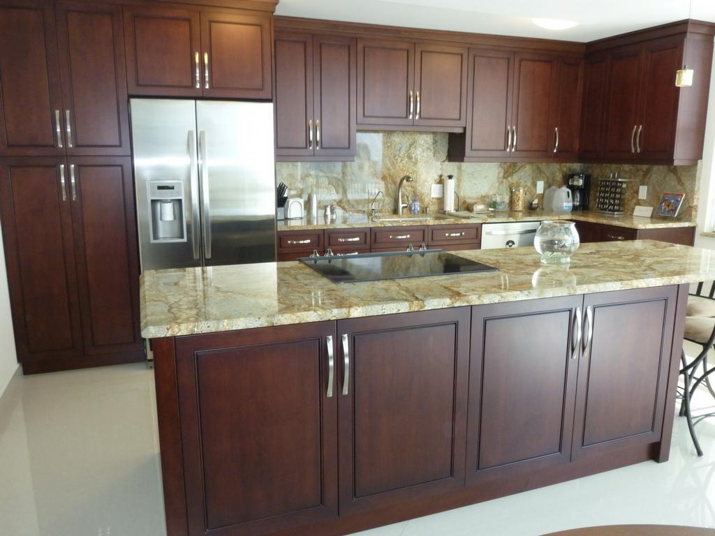 Kitchen cabinets ideas homesfeed for Dark wood kitchen units