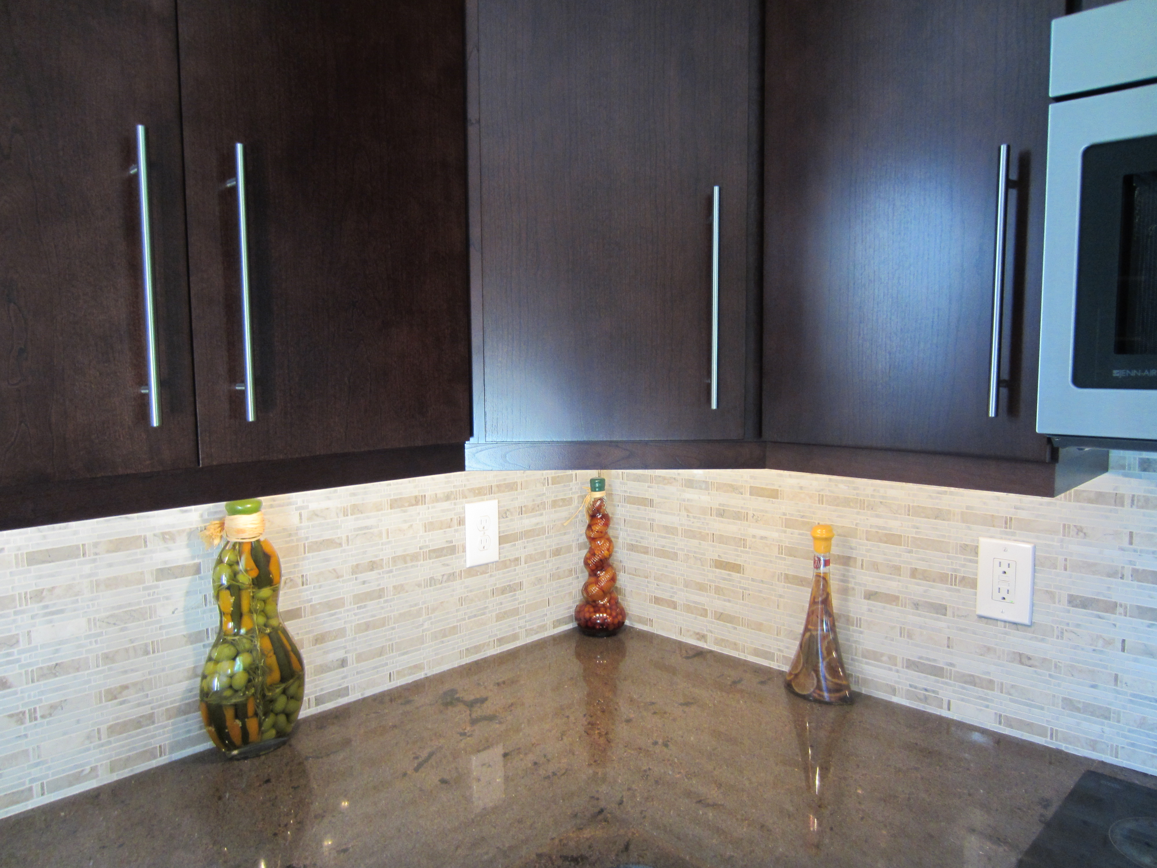 Limestone subway tile backsplash