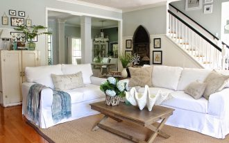 Double White Slipcovered Sofas With Pillows And Wooden Rectangular Table