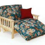 Double futon reclining chair with red accent pillow