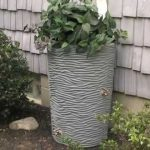 Dual-spigot-decorative-rain-barrels-with-an-artistic-looking-and-has-a-simple-yet-stylish-texture-holds-50-gallons-of-water-also-made-of-durable-resin