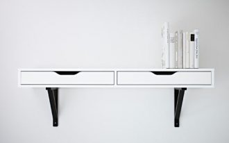 EKBY-ALEX-EKBY-VALTER-as-wall-shelf-with-drawer-in-white-color-with-black-bracket-designed-by-Johanna-Asshoff-features-with-drawer-stops-to-avoid-being-pulled-out-too-far