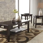Elegant Cocktail Table Set With Warm Rug And Table Lamp