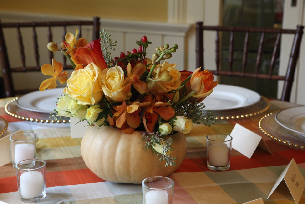 Elegant Fall Center Pieces Of Flowers With Pumpkins And Small White Candles
