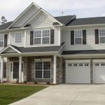 Exterior House Design With White And Grey Color COmplete With Garages