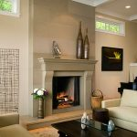 Fireplace Design Ideas With Stone Wall And White Painting Color In Living Room Rectangular Wooden Table And White Sofas