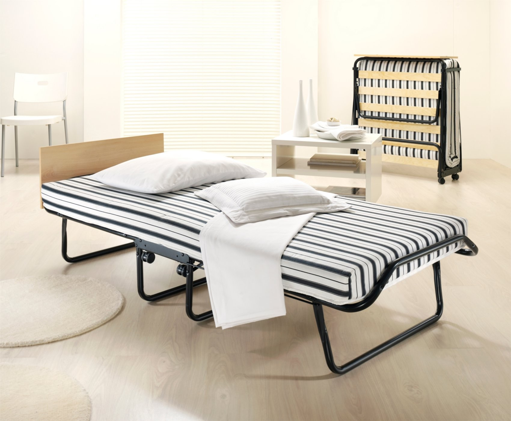 Folding Bed With Striped Mattres And White Pillows Are Perfect For Guest Bed  Solution. Guest Bed Solutions Ideas   HomesFeed