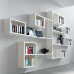 Gorgeous White Stylish Wall Shelves For Books On White Wall