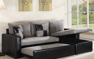 Grey Leather Sectional Of Sleeper Sofa With Pillows In White Room And Large Rug