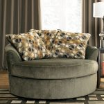 Grey velvet lounge chair in large size with accent pillows