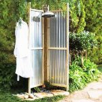 Handmade outdoor shower space with lightweight aluminum panels and free standing showerhead