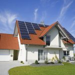 Home With Solar Panels On White House Color
