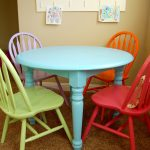 Kida Work Table With Blue Color And Colorful Four Chairs