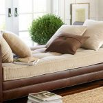 Leather pottery barn daybed furniture with cream mattress and cream pillows and also a smaller brown pillow