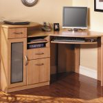 Light Brown Wooden Corner Desk With Three Drawers And Keyboard Shelf