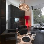 Living Room With Dark Wood Floors And Furniture With Crystal Light Chandelier