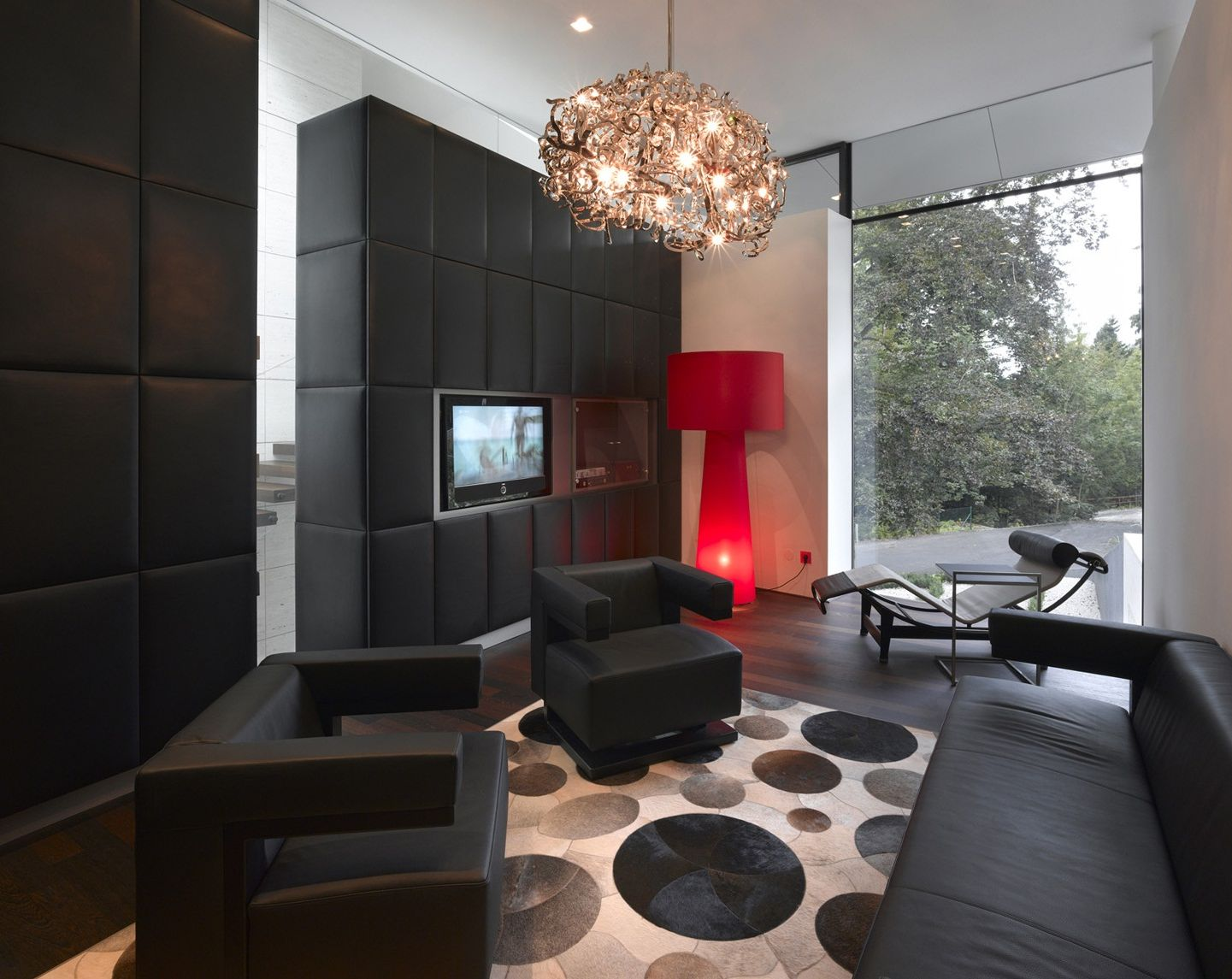 Living Room With Dark Wood Floors And Furniture Crystal Light Chandelier