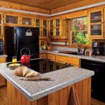 Marble Countertop With Modern Built In Stove Top Design And Awesome Wooden Kitchen Set
