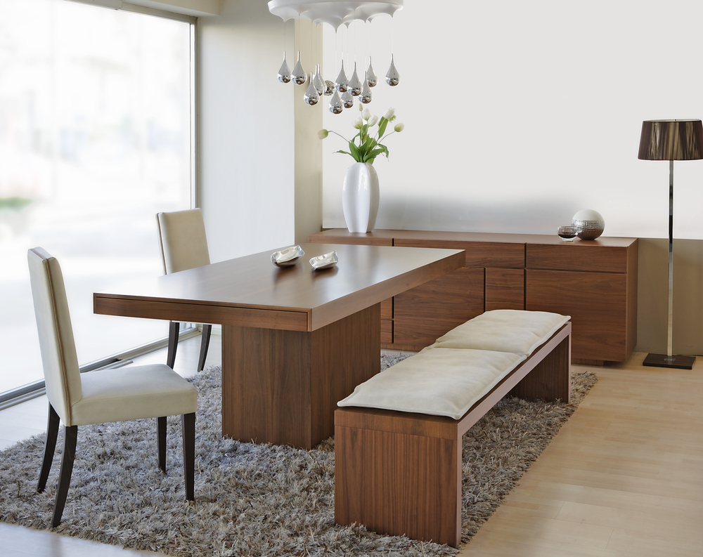 Modern dining room table with chairs and bench design in white wall room and fur rug