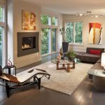 Modern Living Room With Dark Wood Floors With Sectional Sofa And Cool Fireplace