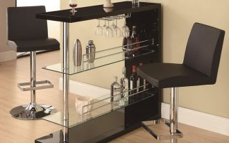 Modern minimalist rectangular pub table in black with transparent under shelves a pair of modern bar stools in black