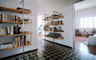 Modern wood and metal book racks that are mounted on wall