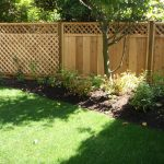 Oak Garden Fencing Ideas Near Green Grass And Lush Trees
