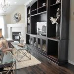 Oakes Style Of Living Room With Dark Wood Floors And Big Hutch