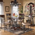 Outstanding Wrought Iron Kitchen Round Table With Chairs Racks And Cool Rug